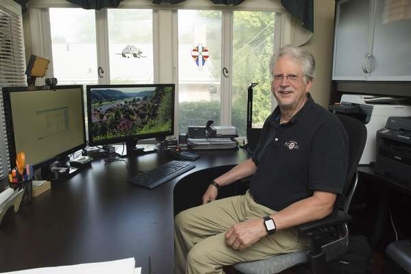 Michelle Davies | The Journal Gazette Duane Yoder, in his home office where he runs PC Dr.