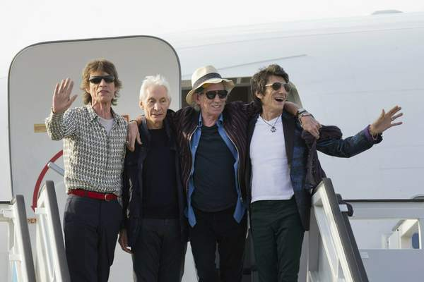 FILE - In this March 24, 2016 file photo, members of The Rolling Stones, from left, Mick Jagger, Charlie Watts, Keith Richards and Ron Wood pose for photos from their plane at Jose Marti international airport in Havana, Cuba. (AP Photo/Ramon Espinosa File)