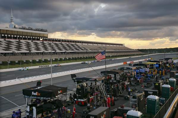 Associated Press Racers speed down the front straight past the empty grandstand during a NASCAR Cup Series race Sunday at Pocono Raceway