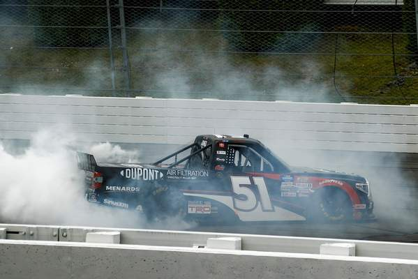Brandon Jones smokes the tires in celebration Sunday after winning the NASCAR Truck Series race at Pocono Raceway.