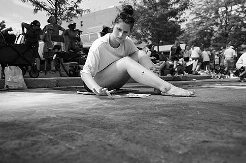 File Kimee Gerhardt takes part in the 2018 Chalk Walk in front of the Fort Wayne Museum of Art.