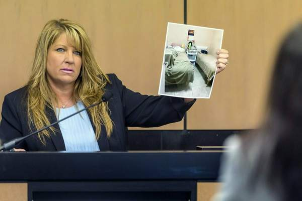 FILE- In this April 30, 2019, file pool photo, Karen Herzog, a Florida Department of Health inspector, shows a photo she took of beds in a room during her inspection of Orchids of Asia Day Spa, during a motion hearing in the Robert Kraft prostitution solicitation case in West Palm Beach, Fla. (Lannis Waters/The Palm Beach Post via AP, Pool, File)