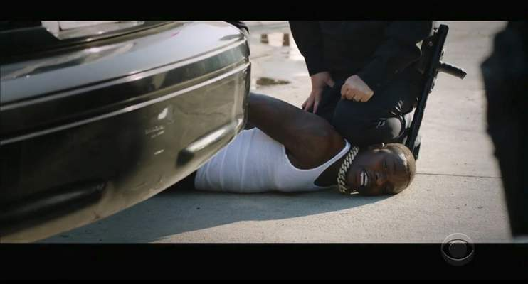 In this video grab issued Sunday, June 28, 2020, by BET, rapper DaBaby performs Rockstar as an actor playing a police officer presses his knee on DaBaby's neck, replicating the last few moments of George Floyd's life, during the BET Awards. (BET via AP)