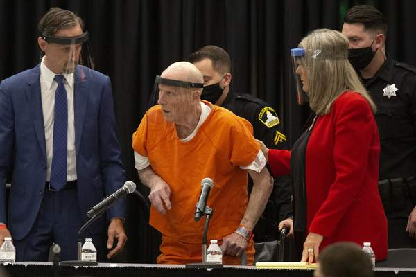 Associated Press Joseph James DeAngelo – the confessed Golden State Killer – is helped up by his attorney, Diane Howard, Monday during his plea hearing, which washeld in a ballroom at California State University in Sacramento.