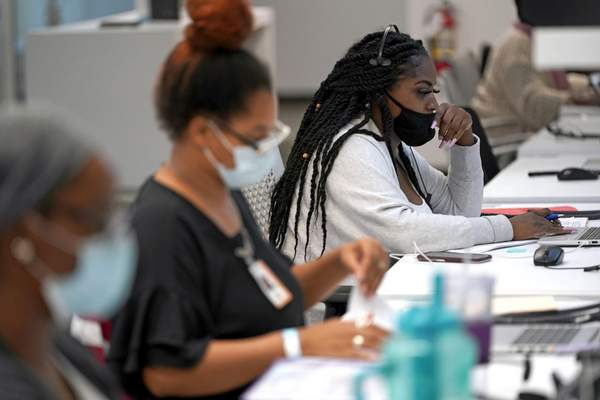 Associated Press Contact tracer Kandice Childress, right, works at Harris County Public Health contact tracing facility in Houston last week.