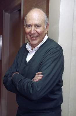 """FILE - In this Oct. 15, 1993 file photo, writer-comedian and film director Carl Reiner, 71, appears after an interview in New York. Reiner, the ingenious and versatile writer, actor and director who broke through as a """"second banana"""" to Sid Caesar and rose to comedy's front ranks as creator of """"The Dick Van Dyke Show"""" and straight man to Mel Brooks' """"2000 Year Old Man,"""" has died, according to reports. Variety reported he died of natural causes on Monday night, June 29, 2020, at his home in Beverly Hills, Calif. He was 98. (AP Photo/Crystyna Czajkowsky, File)"""