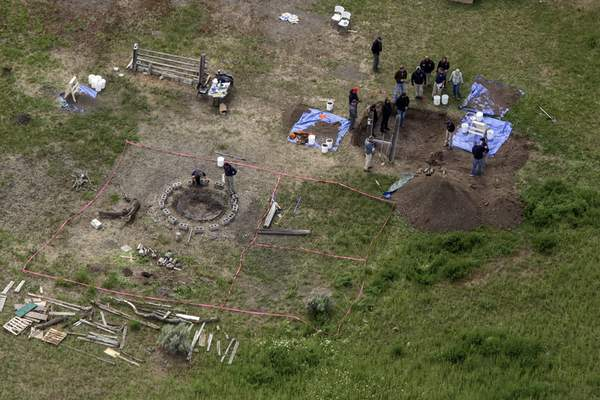FILE - In this Tuesday, June 9, 2020, file aerial photo, investigators search for human remains at Chad Daybell's residence in the 200 block of 1900 east, in Salem, Idaho. (John Roark/The Idaho Post-Register via AP, File)