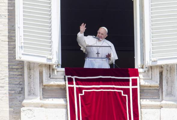 Pope Francis waves to the faithful at the end of the Angelus prayer from his studio window overlooking St. Peter's Square, after celebrating a Mass for the Feast of Rome's Patrons Saints Peter and Paul, at the Vatican, Monday, June 29, 2020. (AP Photo/Riccardo De Luca)