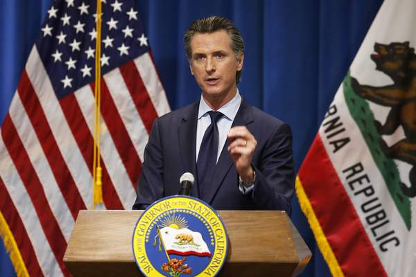 FILE - In this Thursday, May 14, 2020, file photo California Gov. Gavin Newsom discusses his revised 2020-2021 state budget during a news conference in Sacramento, Calif. Gov. Newsom signed a $202.1 billion state budget Monday, June 29, in Sacramento, Calif. (AP Photo/Rich Pedroncelli, Pool, File)