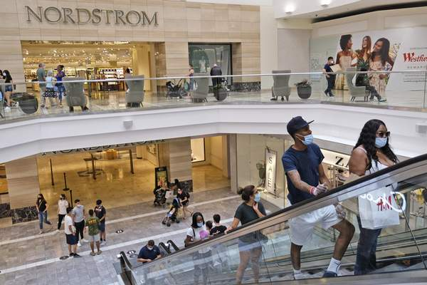 FILE - In this Monday, June 29, 2020 file photo, shoppers move about in Garden State Plaza in Paramus, N.J. (AP Photo/Seth Wenig, File)