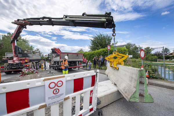 FILE - In this Sunday, June 14, 2020 file photo, a crane removes the concrete blocks that closed customs access, in Thonex near Geneva, Switzerland. (Martial Trezzini/Keystone via AP, File)