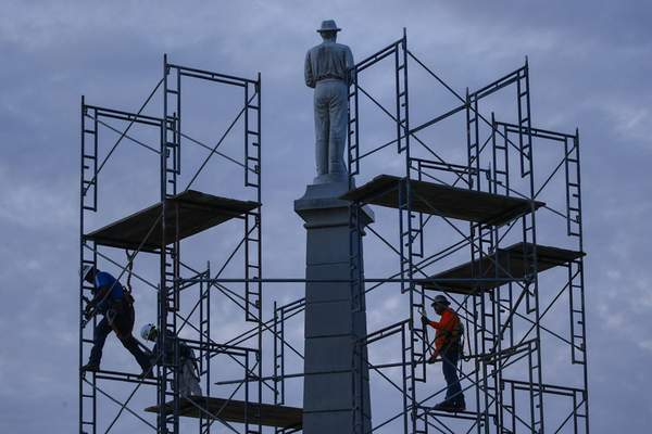 FILE - In this June 24, 2020, file photo, construction workers remove the final soldier statue, which sat atop The Confederate War Memorial in downtown Dallas. (Ryan Michalesko/The Dallas Morning News via AP, File)
