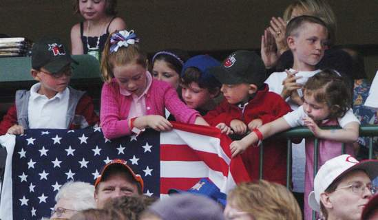 Fans attached an American flag to a railing during the July 4 TinCaps game in 2009. (Cathie Rowand)