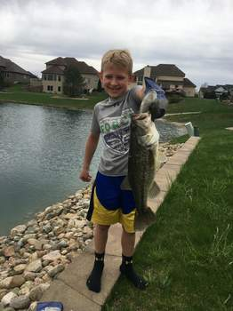 Courtesy photos Brady Urschel, 8, caught this largemouth bass in the pond behind his grandparents' house in southwest Fort Wayne in May.