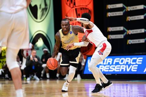 Ben Solomon | Special to The Journal Gazette  Former IPFW player Frank Gaines, left, helped Men of Mackey to a come-from-behind victory today at Columbus, Ohio, in The Basketball Tournament.