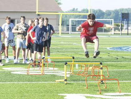 Michelle Davies | The Journal Gazette Woodlan football player David Rodgers Potter runs through a drill Monday morning. High school football players were allowed to return to campus Monday for conditioning drills for the first time since schools closed in March.