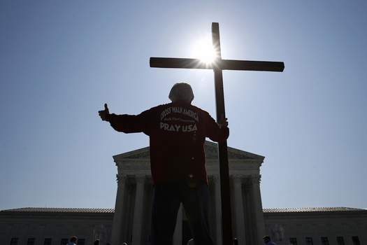 APTOPIX Supreme Court Religious Employees Associated Press  Tom Alexander holds a cross as he prays outside the Supreme Courtin Washington on Wednesday before the court's rulings on two religious freedom cases. (Patrick SemanskySTF)
