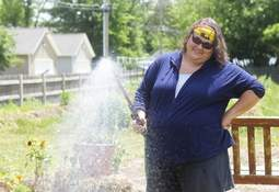 Photos by Katie Fyfe | The Journal Gazette Terri Theisen, manager of the farm and an educator with the Allen County Purdue Extension Service, waters plants at the Johnnie Mae Farm. Theisen says the service has seen an uptick in interest about gardening during the pandemic. It isn't too late to get started with some vegetables.