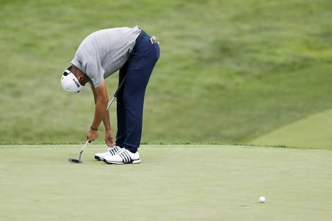 APTOPIX Workday Open Golf Associated Press Collin Morikawa reacts after missing a putt on the 18th hole of the Workday Charity Open on Thursday in Dublin, Ohio.  (Darron CummingsSTF)
