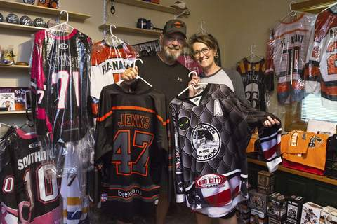 Michelle Davies | The Journal Gazette A variety of Komets' jerseys and assorted memorabilia collected by Bill Oberg and Sue Hansen of Fort Wayne is displayed. The couple collected the jerseys as a way to donate to charity and have recently decided to contact former players to see if they would be interested in receiving the jerseys they wore in Fort Wayne. The couple have accrued 43 sweaters since moving to the city in 2006.