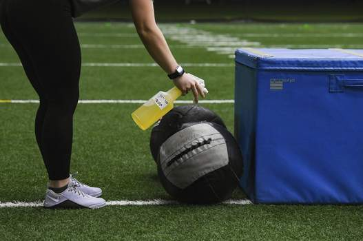 Exchange-Virus Outbreak-Resuming Sports Workout equipment is sanitized after use during high school football workouts, Wednesday, July 8, 2020, at the Sanford Fieldhouse in Sioux Falls, S.D. (Erin Bormett/The Argus Leader via AP) (Erin Bormett