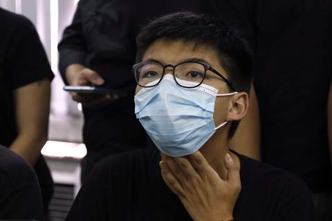 Hong Kong Primaries Joshua Wong, a pro-democracy activist who was elected from unofficial pro-democracy primaries, with others attend a press conference in Hong Kong, Wednesday, July 15, 2020. (AP Photo/Kin Cheung) (Kin Cheung STF)