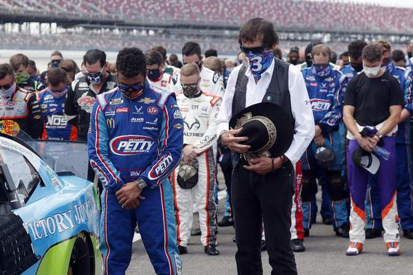 Associated Press  Team owner Richard Petty stands with  Bubba Wallace, NASCAR's only Black driver, before the June 22 race.