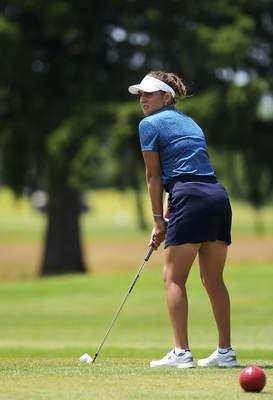Katie Fyfe | The Journal Gazette Brooke Moser tees off at the eighth hole during the second round of the Women's City Golf Tournament at Brookwood Golf Club of Saturday.