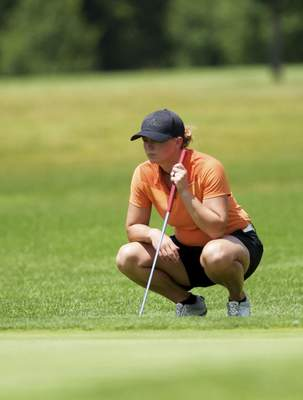 Katie Fyfe | The Journal Gazette  Karley Jump prepares examines the seventh green during the second round of the Women's City Golf Tournament at Brookwood Golf Club on Saturday.