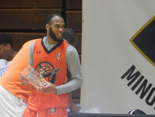 Dylan Sinn | The Journal Gazette Keonte Jenkins accepts the Minor League Challenge MVP trophy after scoring 24 points to lead Fort Wayne to the championship Saturday at Concordia Seminary.