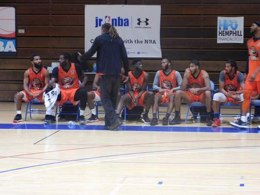 Fort Wayne Flite coach Chief Johnson addresses his team during a timeout at the Minor League Challenge on Saturday. (Dylan Sinn)