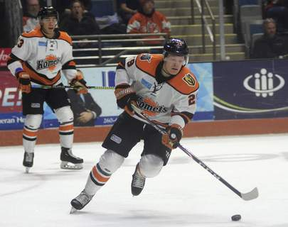 Katie Fyfe | The Journal Gazette  Komets forward Mason Bergh chases the puck during against Kalamazoo last season. Bergh re-signed with the Komets on Monday.