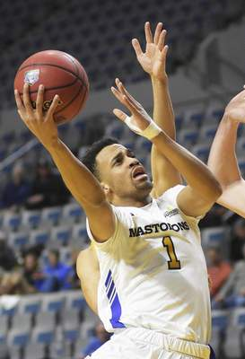 Katie Fyfe | The Journal Gazette  PFW Mastodons guard Jarred Godfrey takes a shot during the first half against the Western Illinois Leathernecks at Memorial Coliseum on Wednesday.