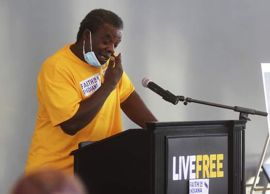 Katie Fyfe | The Journal Gazette  Derek Nelson tears up while giving a testimony on his experience with the police and protesting before main speaker Rev. Naomi Tutu speaks at the Promenade Park Foundation Pavilion on Thursday.