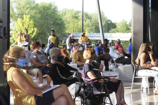 Katie Fyfe | The Journal Gazette  Audience members are seated throughout and outside of the Promenade Park Foundation Pavilion on Thursday.