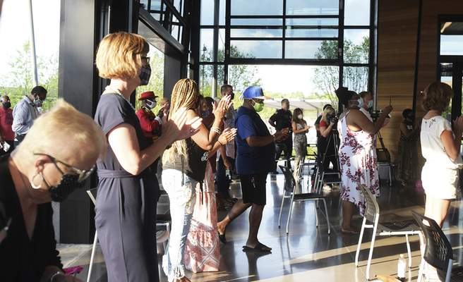 Katie Fyfe | The Journal Gazette  The audience stands and gives a round of applause to welcome Rev. Naomi Tutu at the Promenade Park Foundation Pavilion on Thursday.
