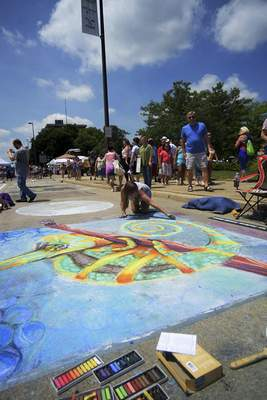 File Fort Wayne Museum of Art's Chalk Walk, typically held during the opening weekend of the Three Rivers Festival, draws thousands of people.