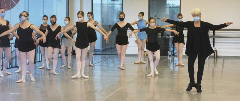 Photos by Michelle Davies | The Journal Gazette Cameron Basden, artistic director of Miami Dance Hub and repetiteur for the Gerald Arpino Foundation, directs students during the Fort Wayne Ballet's Summer Intensive program at Auer Center for Arts and Culture.