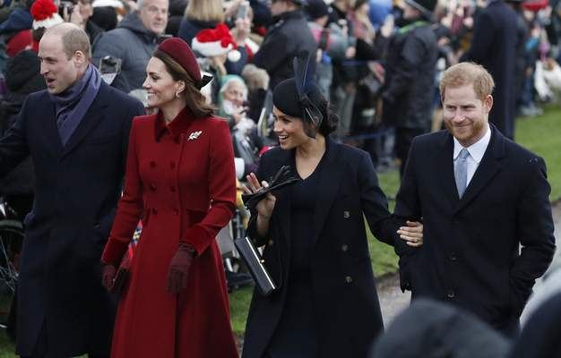 """FILE - In this Tuesday, Dec. 25, 2018 file photo, Britain's Prince William, left, Kate, Duchess of Cambridge, second left, Meghan Duchess of Sussex and Prince Harry, right, arrive to attend the Christmas day service at St Mary Magdalene Church in Sandringham in Norfolk, England. Prince William infuriated Prince Harry when he told his younger brother he should move slowly in his relationship with the former Meghan Markle, fearing that he was being """"blindsided by lust,'' a new book on the Windsors says. The second installment of a serialized version of the book """"Finding Freedom,"""" which appeared in the Sunday Times, Sunday, July 26, 2020 claimed that Harry was angered by what he perceived to be as William's snobby tone in a discussion about the American actress. (AP Photo/Frank Augstein, file)"""