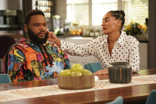 This image released by ABC shows Anthony Anderson, left, and Tracee Ellis Ross in a scene from Black-ish. Anderson and Ellis Ross were nominated for Emmy Awards for outstanding lead actor and actress in a comedy series on Tuesday, July 28, 2020. (Ali Goldstein/ABC via AP)