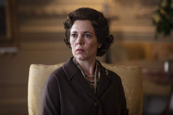 In this image released by Netflix, Olivia Colman portrays Queen Elizabeth II in a scene from The Crown. Colman was nominated for an Emmy Award for outstanding lead actress in a drama series on Tuesday, July 28, 2020. (Sophie Mutevelian/Netflix via AP)