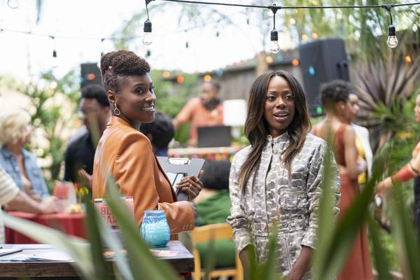 This image released by HBO shows Issa Rae, left, and Yvonne Orji in a scene from the fourth season premiere episode of Insecure. The program was nominated for an Emmy Award for outstanding comedy series on Tuesday, July 28, 2020. (Merie Weismiller Wallace/HBO via AP)