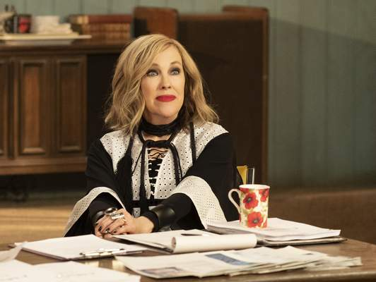 This image released by Pop TV shows Catherine O'Hara in a scene from Schitt's Creek. O'Hara was nominated for an Emmy Award for outstanding lead actress in a comedy series on Tuesday, July 28, 2020. (Pop TV via AP)