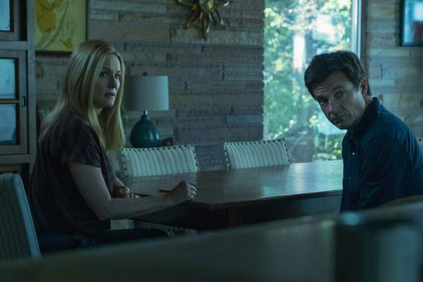This image released by Netflix shows Laura Linney, left, and Jason Bateman in a scene from Ozark. The program was nominated for an Emmy Award for outstanding drama series on Tuesday, July 28, 2020. (Steve Dietl/Netflix via AP)