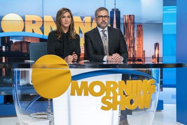This image released by Apple TV Plus shows Jennifer Aniston, left, and Steve Carell in a scene from The Morning Show. (Hilary B. Gayle/Apple TV Plus via AP)