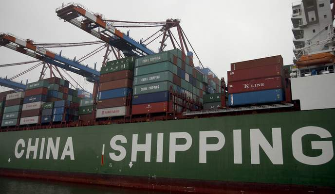 Containers are pictured on board of the 'Star' vessel of the China Shipping Container Lines shipping company at the harbour in Hamburg, Germany, Wednesday, Oct. 29, 2014. (AP Photo/Michael Sohn, File)