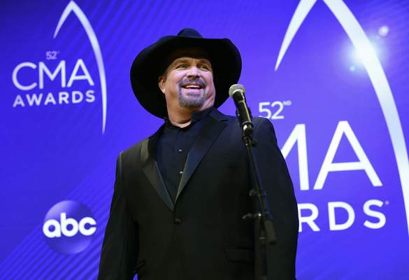 FILE - Singer/songwriter Garth Brooks appears at the 52nd annual CMA Awards in Nashville, Tenn. on Nov. 14, 2018. (Photo by Evan Agostini/Invision/AP, File)