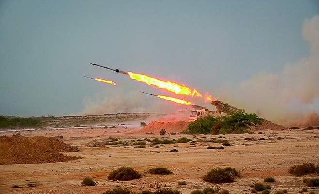 Sepahnews via AP Missiles are launched by Iran's Revolutionary Guard during a military exercise on Wednesday.