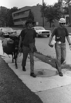 July 30, 1970: Dave Kunst, 30, left, and his brother, John, 23, lead their mule – named Willie Makit – down Maumee Avenue as they travel through the city on their walking journey around the world. The brothers from Waseca, Minn., had already traveled 600 miles. While they were walking along Maumee, Charlotte Brunner offered the mule a drink from her bird fountain and gave the men fresh banana bread.