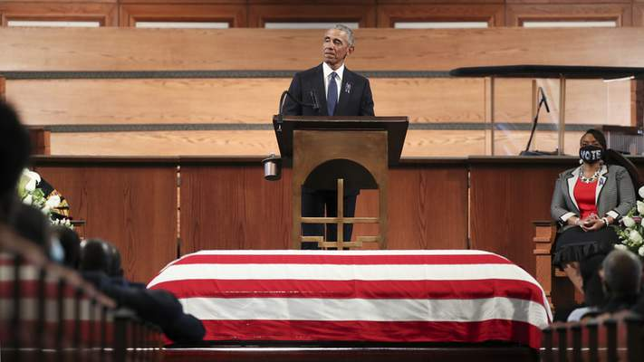 """Associated Press Rep. John Lewis was """"a man of pure joy and unbreakable perseverance,"""" former President Barack Obama said Thursday during the Georgia Democrat's funeral at Ebenezer Baptist Church in Atlanta."""